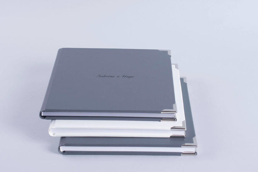 Exclusive embossed debossed text on the cover photo album gray grey material nphoto printing lab for professional photographers metal corners