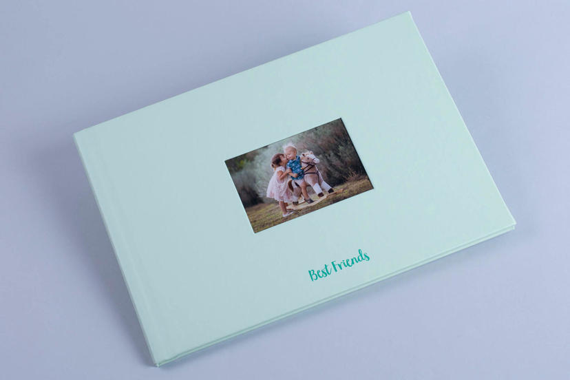 Exclusive lay flat photo album with cut out window cameo window on the cover nphoto printing lab for professional photographers custom text pastel material
