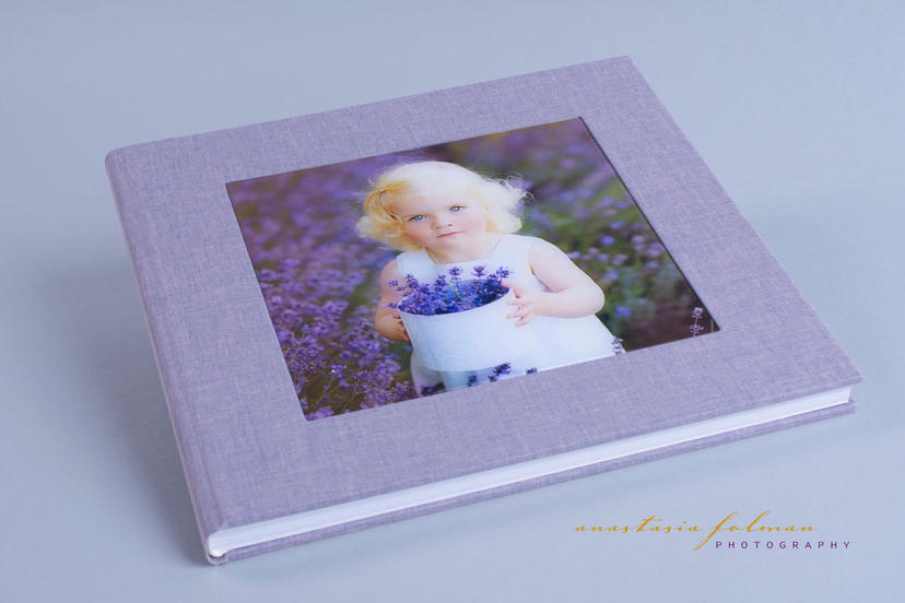 Exclusive lay flat photo album with image on the cover nphoto printing lab for professional photographers baby family photography