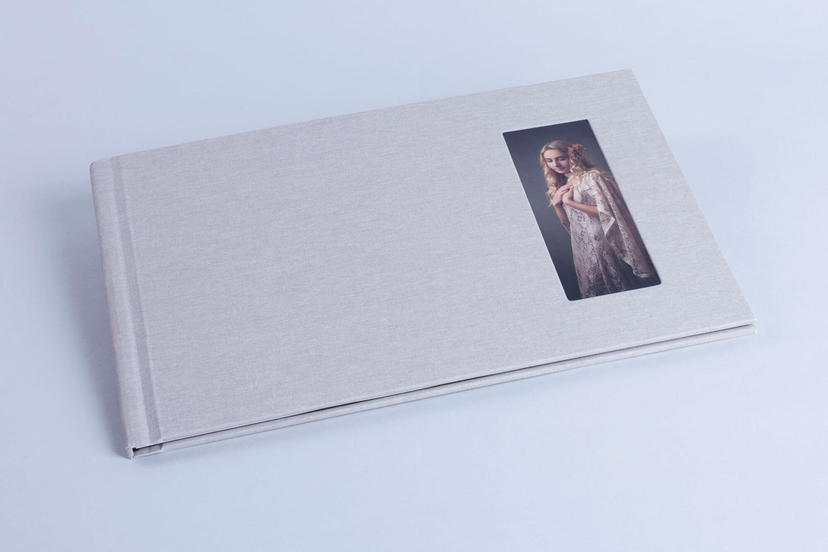 Exclusive photo album with cameo window cut out window with image on the cover nphoto printing lab for professional photographers gray colour