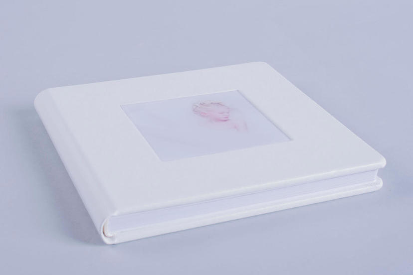 Exclusive photo album with cameo window cut out window with image on the cover white nphoto printing lab for professional photographers