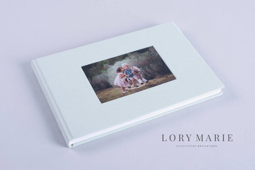 Exclusive photo album with cameo window cut-out window on the cover with image nphoto printing lab for professional photographers newborn photography