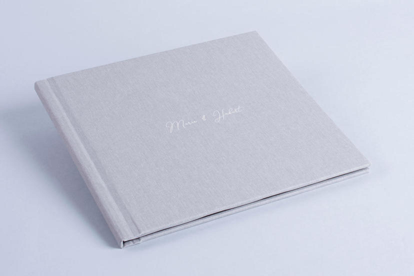 Exclusive photo book with names on the cover white nphoto printing lab for professional photographers